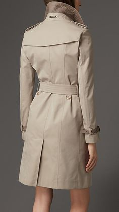 Burberry Stone Leather Detail Gabardine Trench Coat - A slim fit trench coat in cotton gabardine. Invented by Thomas Burberry in 1879, cotton gabardine is a tightly woven, weatherproof fabric that protects against the elements. Discover the women's outerwear collection at Burberry.com