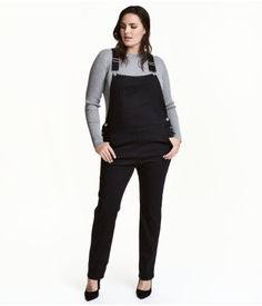 Black. Bib overalls in superstretch twill with adjustable suspenders. Bib pocket, coin pocket, front pockets, and back pockets. Seam at waist with buttons