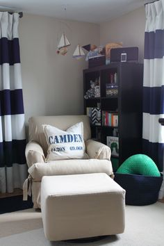 Great nautical theme - and the name Camden pairs nicely with the room's crisp styling.  http://appellationmountain.net/baby-name-of-the-day-camden/