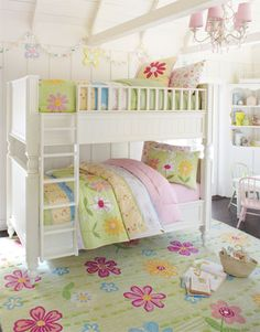 Girly white. Here we chose furniture with a white finish to help the room feel open and sunny, with bedding in a bright mix of colors that recall a fresh spring garden. A crafty garden above the top bunk and a beaded chandelier add a sweet touch of ornate style.