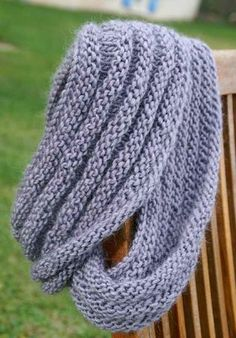 cowl....cast on 100, knit 4 rows, purl 4 rows, repeat until the width you want, end with knit 4 rows and bind off.  Easy!