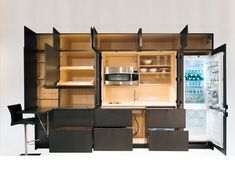 Stealth Kitchen is a modular compact kitchen. This would be perfect for our rental places...