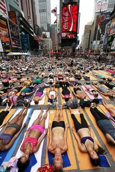 Yoga in Times Square, New York. Photo via MSNBC.