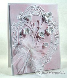 KC Memory Box Bella Bouquet  white cardstock, pink ink with brayer on emboss folder, emboss.