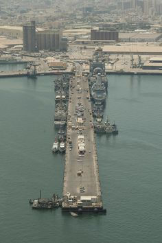 Around the World Wednesday: Check out this aerial shot of U.S Naval ships moored in Bahrain. The Tree of Life, a 400-year-old tree that grows in the Sakhir desert with no water, is also in Bahrain! #Navy #USNavy #AmericasNavy navy.com
