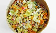 Ingredients: 1 medium-large tomato, diced 4 oz 50% less fat or 2% sharp cheddar cheese, shredded 4 oz nacho cheese Doritos, broken up a bit into bite sized pieces 1 lb 95% lean ground beef 1 (1.25 oz) packet reduced sodium taco seasoning 1 medium-large head of iceberg lettuce, chopped into bite sized pieces 1 cup light Catalina or French dressing Directions: Brown the ground beef in a skillet over medium heat, breaking it up into pieces with a wooden spoon. Add the packet of taco seasoning…