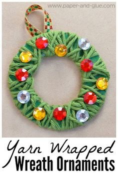 Yarn Wrapped Christmas Wreath Ornament Craft For Kids.  Fun and easy craft for preschool, kindergarten, or elementary.  Great fine motor work, with simple set-up for class parties.