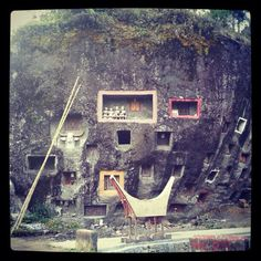 Huge stone burial site at Loko' Mata, South Sulawesi - Indonesia. People in Toraja (etchnic group) bury the corpses in the cave or stone or a more modern way inside a small house dedicated for the corpses. This huge stone burial site looks like a giant spaceship with aliens inside examining the dead human bodies