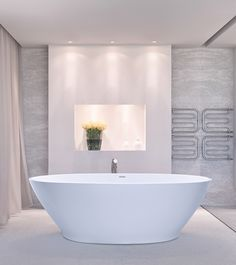 This version of the Alissa meets the popular desire for a tub. In the same, clean and simple lines that are proportioned as the larger freestanding oval bathtub. Beach House Bathroom, Modern Bathroom, Master Bathroom, Stone Bathtub, Soaker Tub, Soaking Bathtubs, Luxury Bath, Amazing Bathrooms