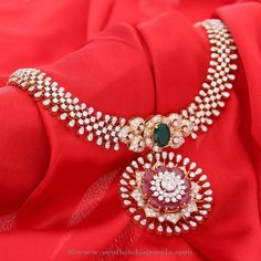 Stunning latest model diamond necklace embellished with rubies and emeralds. For inquiries please contact the seller below. Seller Name : Manubhai Jewellers