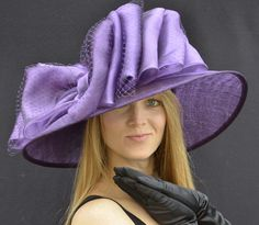 A true Southern Bell hat! Kentucky Derby for sure! (With a long black lacy dress, lilac sandals, black pearls and an awesome lace fan)