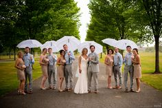 Smiling bridal party holds white umbrellas  #Michiganwedding #Michiganwedding #Chicagowedding #MikeStaffProductions #wedding #reception #weddingphotography #weddingdj #weddingvideography #wedding #photos #wedding #pictures #ideas #planning #DJ #photography #bride #groom