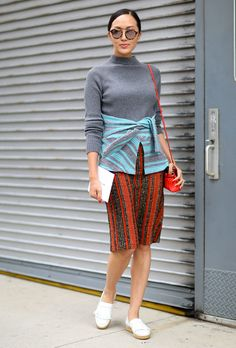 Spring Work Outfit Ideas | Fashion-forward knit skirt styled with a gray turtleneck sweater and white loafers.