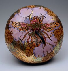 Bee & Flower by gourd artist, Carla Bratt. I love bees and of course, flowers. Gourd art that glows from the use of metallic leaf.