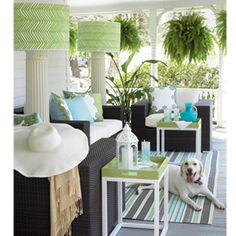 See how style expert Eddie Ross gave columns a new use as floor lamps on this summery beach hued porch.