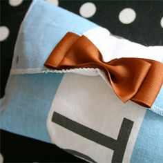 You don't have to be good at sewing to take your old TOMS flag and turn it into a cute clutch! Other TOMS flags tutorials posted as well
