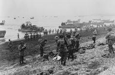 Landing boats pouring soldiers and their equipment onto the beach at Massacre Bay, Attu Island, Alaska. This is the southern landing force on May 11, 1943. The American and Canadian troops took control of Attu within two weeks, after fierce fighting with the Japanese occupying forces. Of the allied troops, 549 were killed and 1,148 wounded -- of the Japanese troops, only 29 men survived. U.S. burial teams counted 2,351 Japanese dead, and presumed hundreds more were unaccounted for.