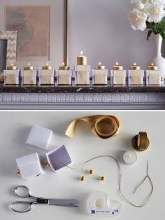 Make your mantle shine with a chic Menorah made with neutral-colored boxes and metallic candles.