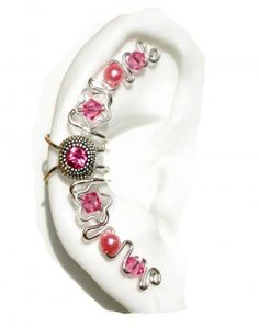 Unique and elegant look! Embellish your ears with this ear cuff jewelry wrap!   This piece has  a Pink Rhinestone Center Jewel, made with silver wire, pink  crystals and pink glass faux-pearls. PATENTED DESIGN  handmade in the USA. - See more at: http://www.earlums.com/shop/ear-cuff-jewelry/#sthash.dUxdvwDM.dpuf