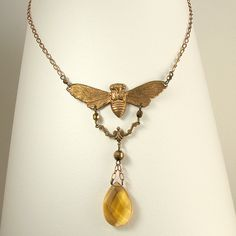 necklace, moth masquerading as a honeybee by Adornments NYC, via Flickr