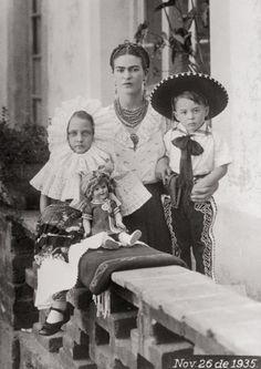 Frida Kahlo with unk. children in tehuana dress. 1935, oaxaca
