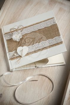 Handcrafted vintage guest book embellished with burlap, broderie ribbon and lovely flower.