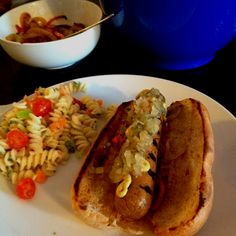 No animals were harmed in the making of this sausage.   Tofurkey Kielbasa with peppers and onions and vegan summertime pasta salad.