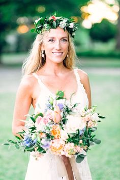Love this bride! Flower Crown & Bridal Bouquet; Dahlias, Peonies, Ranunculus, Sweet Pea, Queen Anne's Lace,  Delphinium, Feathered & Standard Eucalyptus, Ruskus; Poplar Grove Plantation; Sean Carr Photography; Design Perfection Weddings