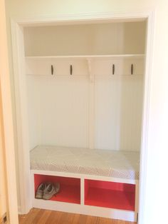 1st DIY project in our new home | Hallway closet conversion to simple bench and hooks | black boat cleats, Nate Berkus fabric for bench cushion, terra cotta red valspar paint (inside an IKEA media cabinet).