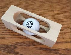 Putting this Golf Ball into a Block of Wood is a quickie woodworking project that is fun and simple project. In this video I'll show how I made one with a fe...