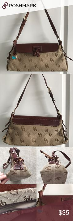 Dooney & Bourke shoulder purse In good condition the leather flap has some scratches and the corners have some wear. Size 13x 6 Dooney & Bourke Bags Shoulder Bags