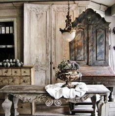 Google Image Result for http://3.bp.blogspot.com/_QAOnJuGRxt8/TUwB0upyCaI/AAAAAAAAAgI/R9_re-lootg/s1600/french-table-antiques-cupboard-gray-blue-furniture-light-fixture-brocante-flea-market-style-home-room-decorating-interior-design-eclectic-ideas.jpg