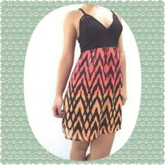 Fox dress NWT NWT fox racing cute dress with cut outs on top of chichi's  there is no rips or stains on this cute fun flirty dress. The outer part of the lower half is a sheer with a lining under Fox Dresses Mini