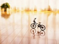 Love the feeling of space, reflecting light and a warm glow, with a toy bike to make it inviting for young visitors