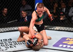 Rose Namajunas (top) pictured punching her fellow American Paige VanZant in their UFC strawweight bout in Las Vegas on Thursday Ufc Rose Namajunas, Las Vegas, Paige Vanzant, Ufc Fight Night, Female Fighter, Win Or Lose, Garage Gym, Martial Artist, Tough Guy