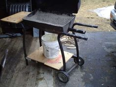 gas blacksmith forge made out of an old bbq grill