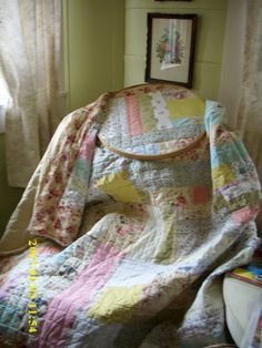 a childs quilt I hand pieced and hand quilted using scrap fabric used in other children quilts I've made.