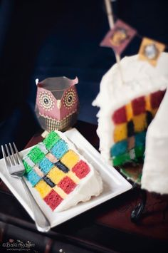 A cake dedication to Hogwarts - spice cake with cream cheese frosting, with vertically filled layers in the Hogwarts house color