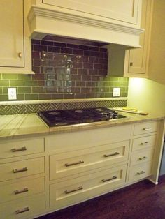 Plaza-condo-remodel-kitchen-built-in-professional-stove-hood-tile-cabinets