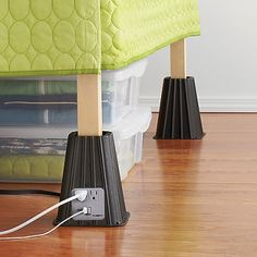 Raise your bed off the floor to create storage space underneath. These bed risers also feature power outlets to charge your gadgets. | HellaWella #organization #homeorganization #organizationtips