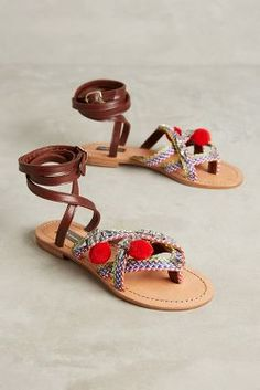 31551ef362f Shop the Rada Red Pom Slingback Sandals and more Anthropologie at Anthropologie  today. Read customer
