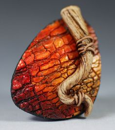 Polymer clay brooch with faux wood and crackle effect by Sylvie Peraud of Fimo Maniguette.
