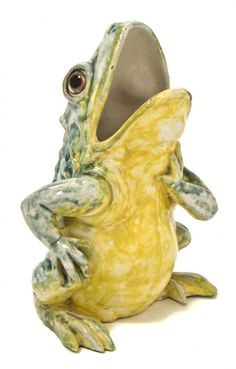 A French Majolica Figural Vase, St. Honore, in the form of a frog looking skyward with glass eyes and open mouth.