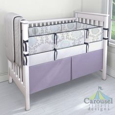 Crib bedding in Pink and Gray Rosa, Solid Navy, Solid Lilac. Created using the Nursery Designer® by Carousel Designs where you mix and match from hundreds of fabrics to create your own unique baby bedding. #carouseldesigns