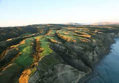 Golf in New Zealand, couldn't play it, but would like to see it.  Maybe another New Zealand course to play.