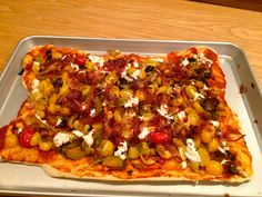 Flat bread with caramelized onions, cherry tomatoes, goat cheese and olives.  Very yummy!