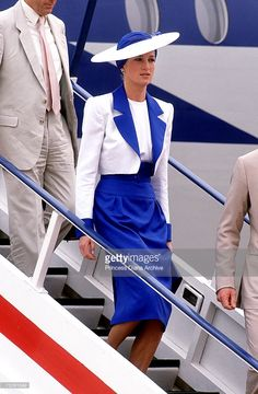 The Princess of Wales, wearing a suit by Catherine Walker and Philip Somerville hat, arriving in Dubai, March 1989.