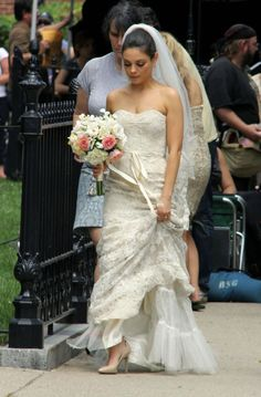Absolutely HATED the movie Ted, but loved Mila Kunis and her wedding dress- she looked amazing.