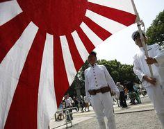 Japanese Soldier Rising Sun Flag   dressed as Japanese imperial soldiers hoist Japan's rising sun flag ...