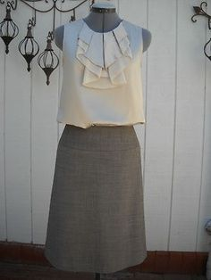Pleated cream top and grey skirt.